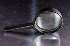 El vintage magnifica la lupa de cristal Imagen de archivo
