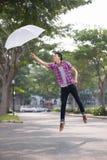 El volar con un paraguas Imágenes de archivo libres de regalías