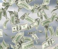 El volar de los billetes de dólar Fotos de archivo libres de regalías