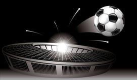El volar del balón de fútbol del estadio Fotografía de archivo