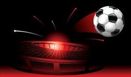 El volar del balón de fútbol del estadio Fotografía de archivo libre de regalías
