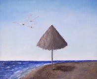 El volar del parasol de playa y de las gaviotas Fotografía de archivo