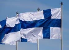 El volar finlandés de tres banderas Foto de archivo libre de regalías