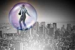 El vuelo del hombre de negocios dentro de la burbuja Foto de archivo libre de regalías
