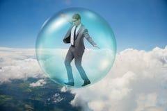 El vuelo del hombre de negocios dentro de la burbuja Fotografía de archivo