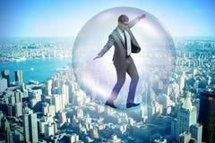 El vuelo del hombre de negocios dentro de la burbuja Imágenes de archivo libres de regalías