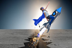 El vuelo del niño del super héroe en el cohete Fotografía de archivo libre de regalías