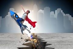 El vuelo del niño del super héroe en el cohete Fotos de archivo libres de regalías