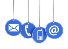 El web nos entra en contacto con los iconos en etiquetas azules Foto de archivo