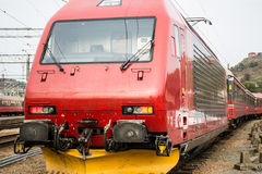 EL18 Locomotive at station. El 18 is an electric locomotive used by the NSB in Norway to pull passenger trains on the electrified sections. The locomotive runs Royalty Free Stock Photo