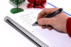Elaboración de la lista de la Navidad fotografía de archivo