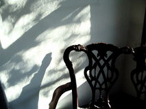 Elaborate backed chair and shadow Stock Image