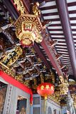 Elaborate Carvings and Decorations Atop Thian Hock Keng Temple E. Golden reliefs and lantern atop the entrance of Thian Hock Keng Temple. The temple is the royalty free stock photography