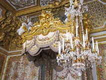 Elaborate Chandelier and Bed Detail at Versailles royalty free stock image