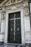 Elaborate church door. A view of an elaborately decorated door at a church in Rome Stock Photo