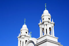 Elaborate Church Steeples. On a sunny afternoon Royalty Free Stock Photos