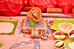 Elaborate decorations besides the rangoli during wedding ceremony in India. Elaborate decorations besides the rangoli with fruits and a coconut, during wedding Royalty Free Stock Images