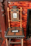 Elaborate design of carved wood and stone tile chair Stock Photo