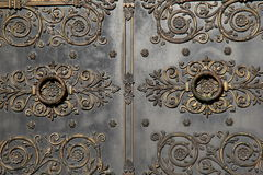 Elaborate detail in scrollwork of impressive doors Royalty Free Stock Images