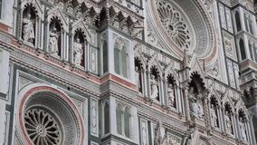 Elaborate front of the Florence Cathedral in Italy stock footage