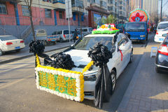Elaborate funeral car. The Chinese elaborate funeral cars stand along street Stock Image
