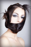 Elaborate hair styling. Young beautiful model posing with an elaborate hair styling Stock Photography