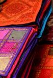 Elaborate handkerchiefs. A closeup of piles of colorful ethnic handkerchiefs Stock Images