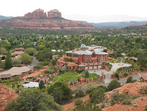 Elaborate mansion in Sedona, Arizona. Elaborate mansion with extensive surrounding gardens as seen from a hilltop overlooking Sedona, Arizona with red sandstone Stock Images