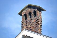 Elaborate Red Brick Chimney Stock Images