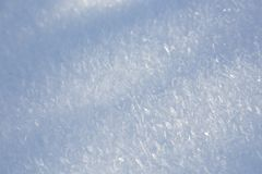Elaborate Snow And Ice Flowers. Elaborate glittering ice flowers on snow after a freezing night in the Eifel, Germany Stock Image