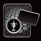 Elaborate trophy on black hexagon banner Royalty Free Stock Image