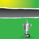Elaborate trophy on green ripped banner Stock Images