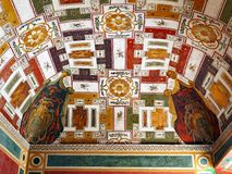 Elaborate Vaulted Ceiling, Villa d`Este, Tivoli, Italy. A colourful and elaborate vaulted ceiling in the historic Villa d`Este, Tivoli, Italy. Tivoli was an Stock Photo