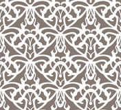 Elaborate white vintage seamless pattern on brown background Stock Photos