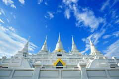 White Buddhist Pagoda with multiple spires at Wat Asokara Temple in Thailand Royalty Free Stock Photography