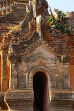 Elaborately carved doorway of  ancient Buddhist stupa Royalty Free Stock Photos