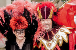 Elaborately dressed gay couple. BERLIN, GERMANY - JUNE 21, 2014:Christopher Street Day.Elaborately dressed people participate in the parade celebrates gays Royalty Free Stock Image