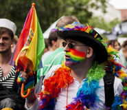 Elaborately dressed man during gay pride parade Stock Photos