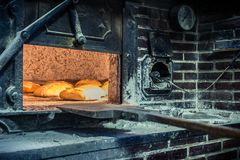 Elaboration of bread in traditional wood oven. Bread in traditional wood oven royalty free stock image