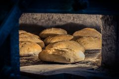 Elaboration of bread in traditional wood oven stock images