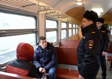 Elaboration by police officers of the suppression of violation of public order in the car of an electric train. Stock Photo