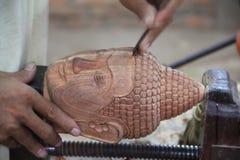 Elaborazione del legno della testa di Buddha Fotografia Stock