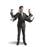 Elaborazione multitask dell'uomo d'affari Immagine Stock Libera da Diritti