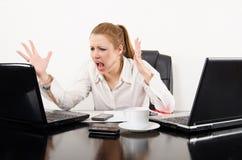 Elaborazione multitask della donna di affari Fotografie Stock