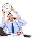 Elaborazione multitask occupata dell'uomo d'affari Immagine Stock