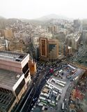 Elaf Al-Mashaer Hotel and people walking on the street at the holy city of Makkah in Saudi Arabia. royalty free stock images