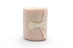 Elastic ACE compression bandage warp unwrapped. Isolated stock photo
