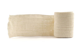 Elastic ACE compression bandage warp. Unwrapped, isolated over white background stock images