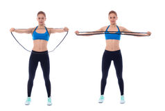 Elastic band splitter. Elastic band exercises executed with a professional trainer Royalty Free Stock Photo