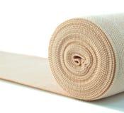 Elastic bandage. Roll of elastic bandage isolated on white background Royalty Free Stock Photo